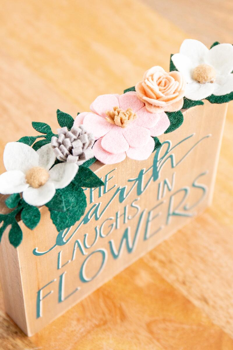 The Earth Laughs in Flowers Box Sign- Brown 2