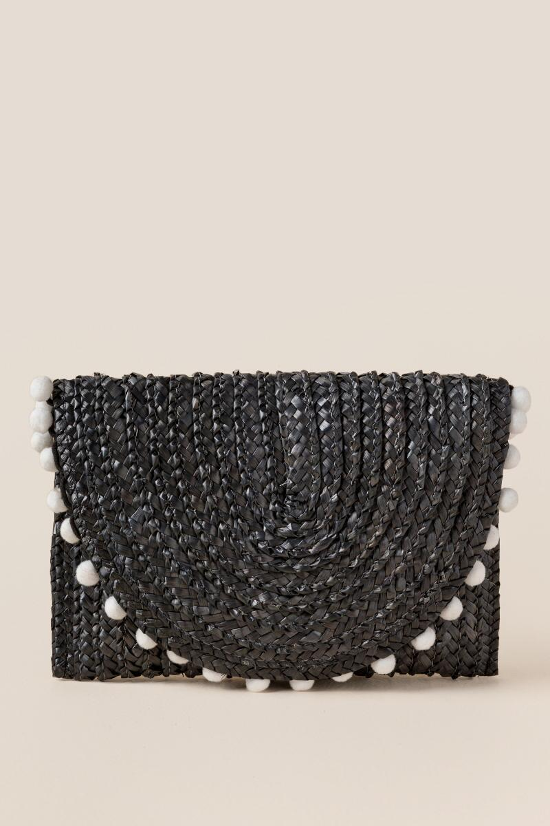 Reagan Straw Pom Clutch in Black