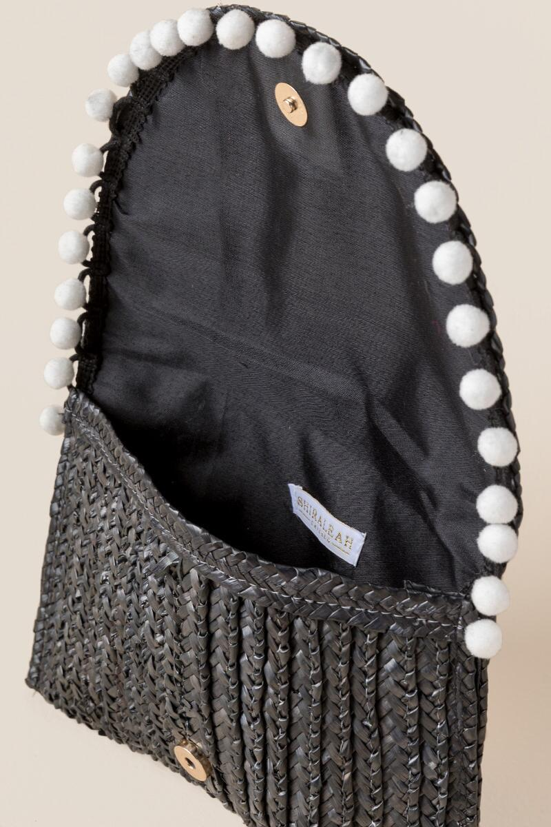 Reagan Straw Pom Clutch in Black-  blk-clinside